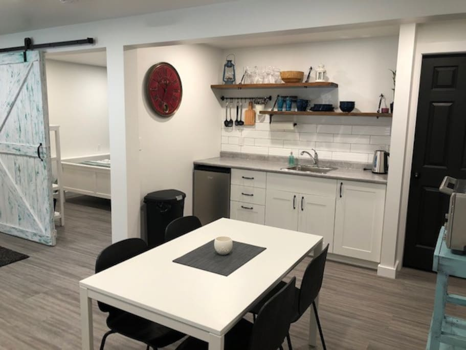 Dining area and kitchenette with entrance to bedroom