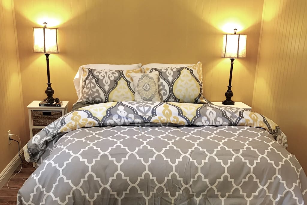 Big fluffy new comforter and plush pillows on your queen size bed in the bedroom to dream your cares away.