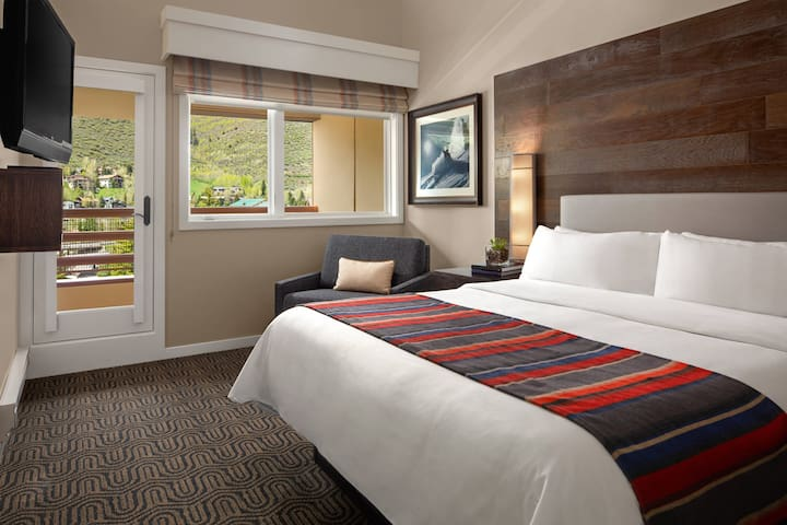 Master Bedroom offers a comfortable  king-size bed, twin bed chair, balcony and a full bath.