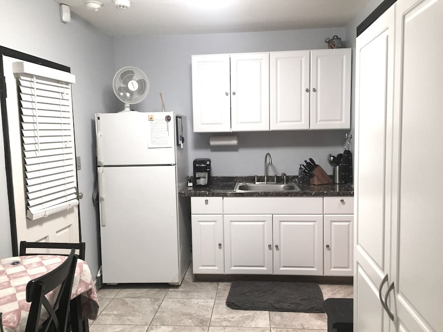 CLEAN!! Full-size refrigerator, sink,  Keruig , coffee maker fully stocked cabinets and large closet. No oven or stove. Air conditioning and fans.