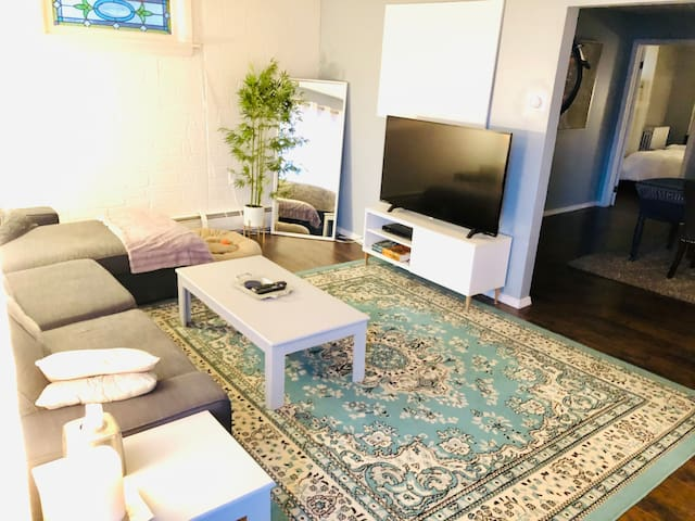 This is the living room, with a newly upgraded L-shape couch for comfier, relaxing TV nights. Entertainment console is configured with an easily-marked HDMI cable already hooked up to TV, and a clearly-marked Internet-ready Ethernet hook up as well.