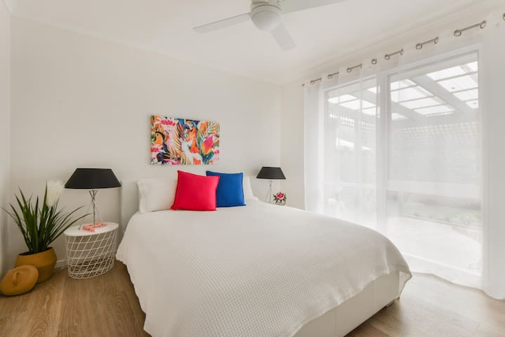 Master bedroom with comfy queen size bed & smart TV