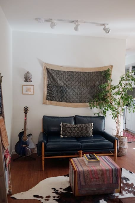 Cozy living area decorated with textiles from our travels around the world