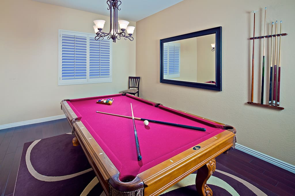 Fun game room with pool table.