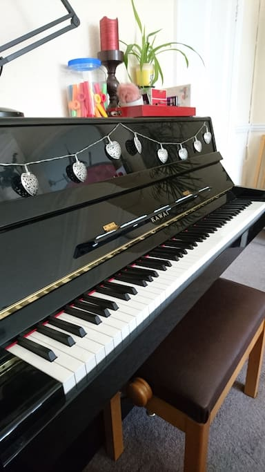 lovely Kawai upright piano, in tune (natch) - feel free to play