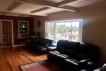 Shared space , living room , sitting table , TV , microwave, large bay window . This space is left primarily for you when during your stay .