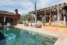 Gorgeous Infinity pool with heated spa' multiple standing heaters, outdoor dining room table and cozy furniture