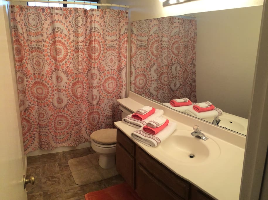 Spotlessly Clean Bathroom With Amenities