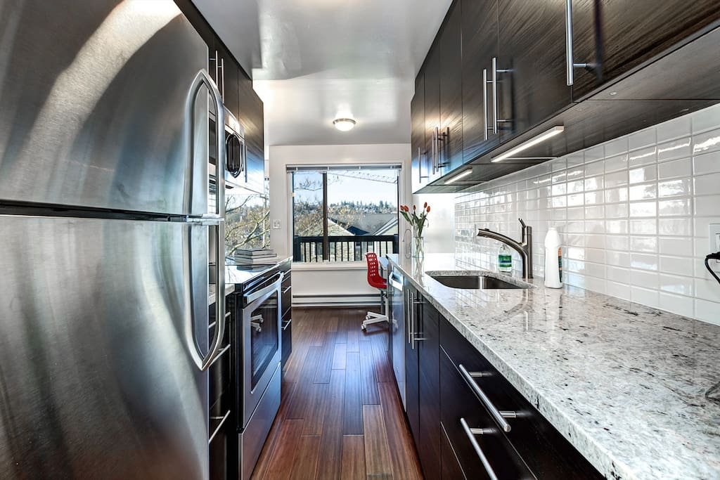 Stainless steel appliances. Large windows let in plenty of light.