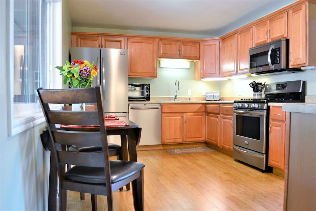 Eat in kitchen with a gas range, refrigerator with filtered water, microwave, toaster oven, and dishwasher.  Fully stocked with pots/pans and utensils for cooking or eating in.