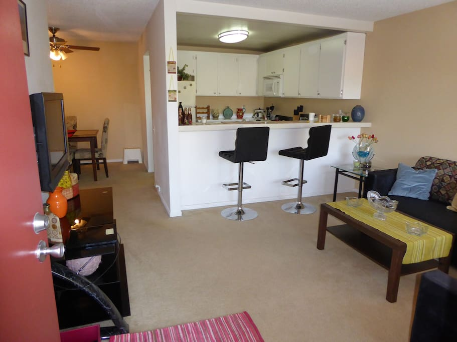 Entrance, Living Room, TV, chairs, 2 couches