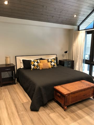 King master bedroom with french windows overlooking screened in porch