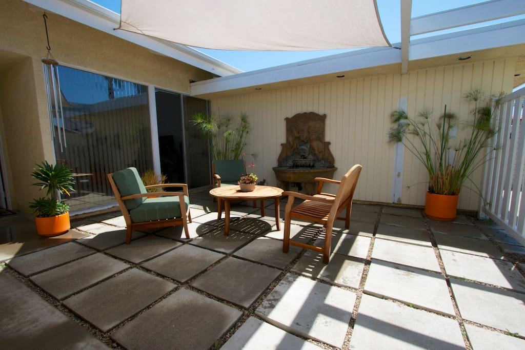 Relax, recline and read in the tranquil front courtyard.