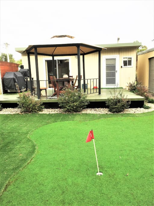 Backyard of cottage with putting green. Winter 2018.
