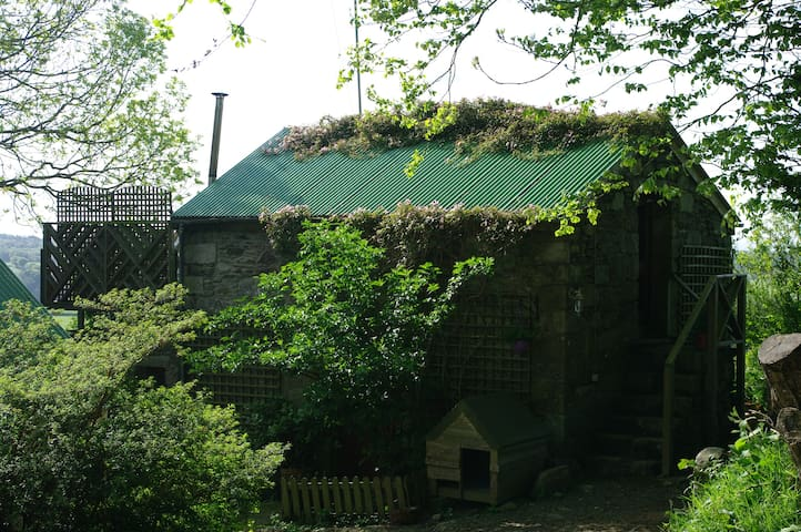 Double storey stone walled cottage with sun deck