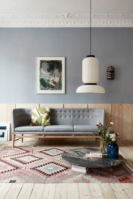 Lounge with white stained plywood high-panelling