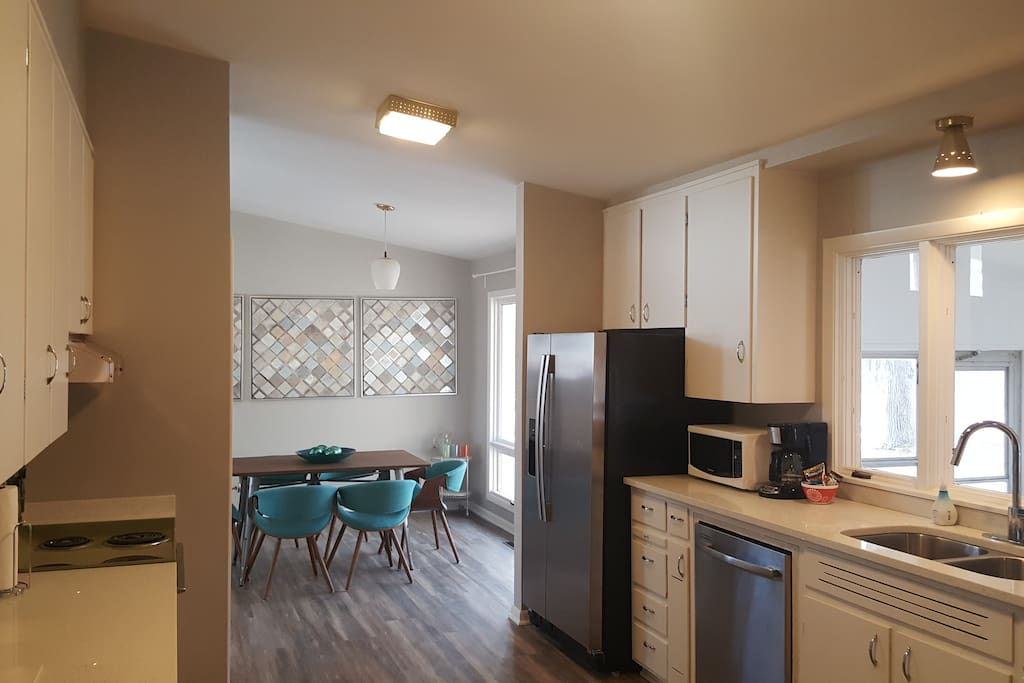 The Kitchen - Retro and modern, open and airy. Includes fridge with filtered water and ice, stove, oven, dishwasher, microwave, toaster, and coffee for your morning wake-me-up. The kitchen is stocked with cooking tools.