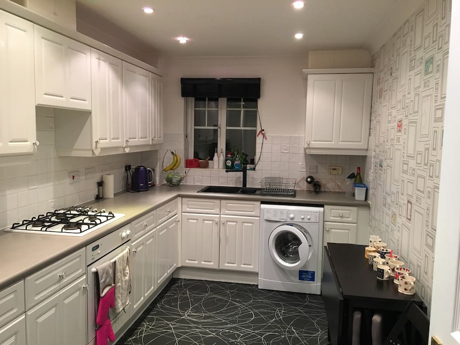 Separate kitchen with washer dryer and gas hob