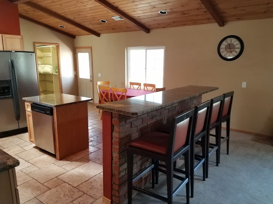 Newly redone granite counter tops and tile floor.