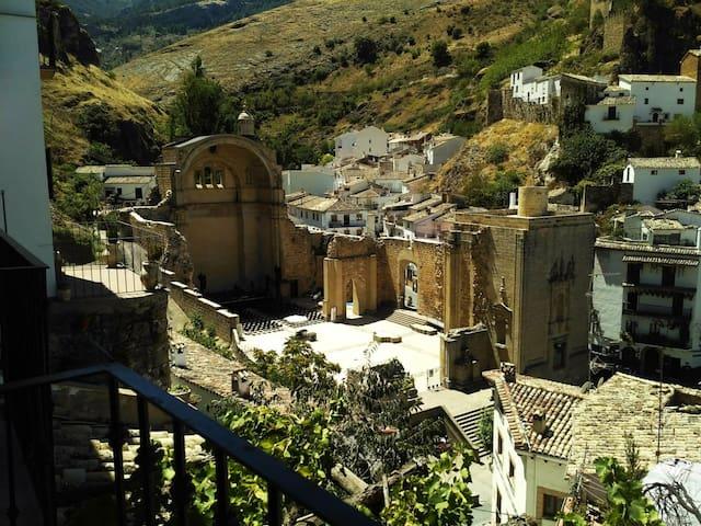 balcony view of ruins of St. Mary Church (ruinas de Iglesia de Santa Maria) & 9th Century Moorish Castle (Castillo de las Cuatro Esquinas)