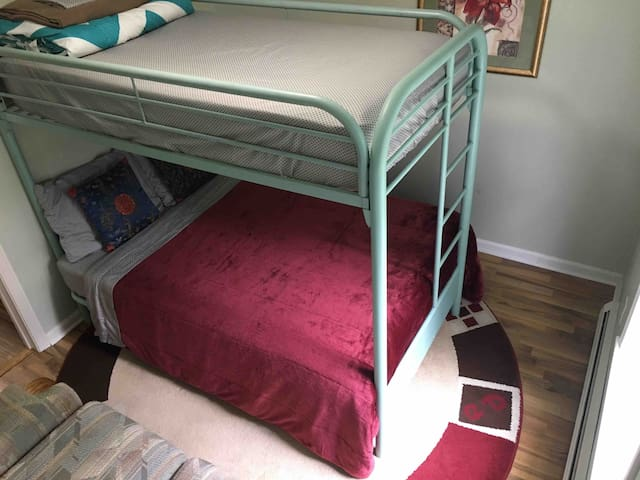 Bunk bed in first floor bedroom consists of a full size bed on bottom and a twin size bed on top. It is very sturdy (anchored to wall) and comfortable.
