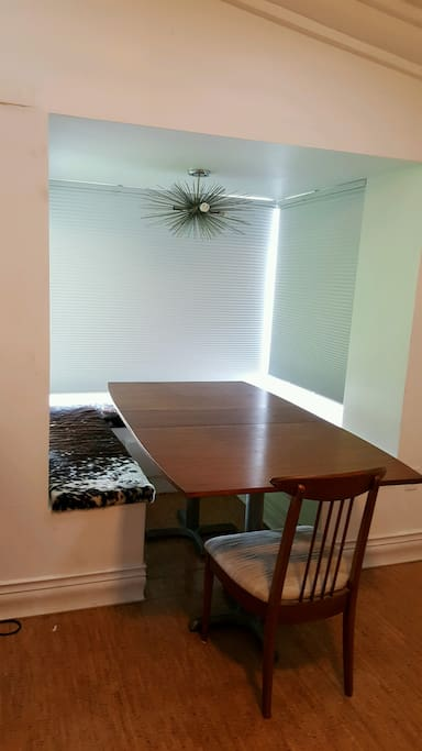 Unique dining area - perfect for enjoying a morning cup of coffee. a candlelight dinner or entertaining a crowd.