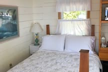 Guestroom #1 with bright & cheery linens and decor