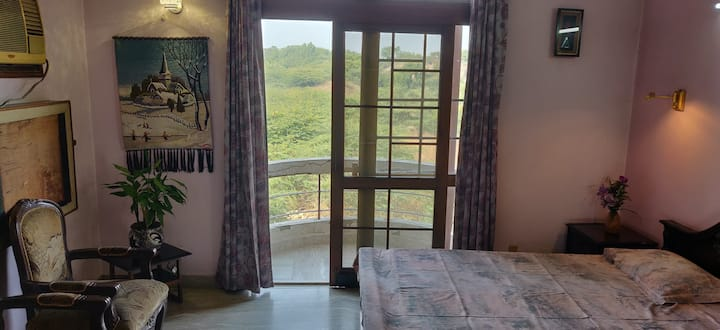 Wake up to views of the Qutub Minar near Saket