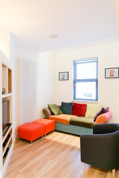 Bright, cosy and colourful sitting room