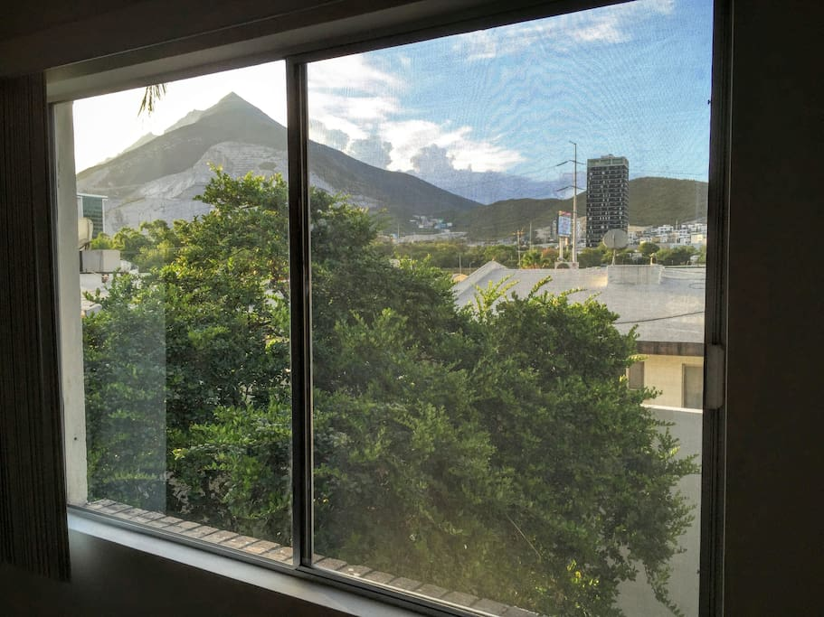 The view of the Room is from the back of the house where you can spot some of the city's mountains.
