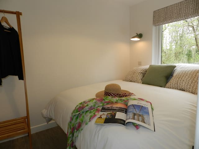 Comfortable double bedroom at the rear with woodland views. Wall mounted tv.