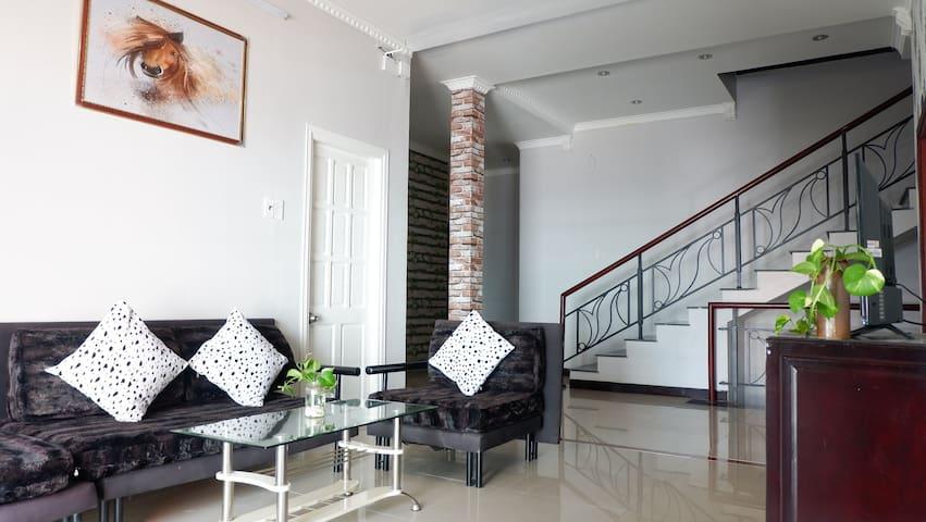 Vung Tau Villa Ali 5B has a spacious living room in the first floor with TV, sofa, bookshelf