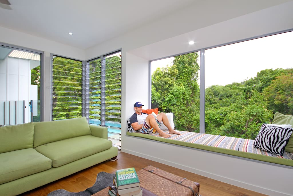 Relax on the day bed overlooking the rainforest.