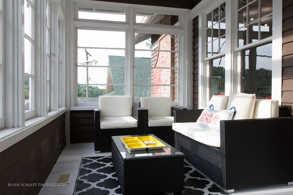 The front porch is completely screened in which is perfect for relaxing in the sun without the bugs.