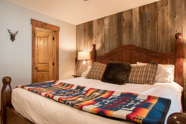 Warm up under fluffy down comforter and Pendleton blanket. Comforters are switched to lighter ones in the summer. I get lots of good feedback about the comfy mattresses.