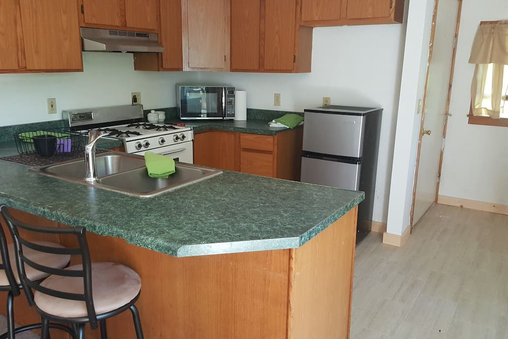Sit at counter-top and spacious kitchen