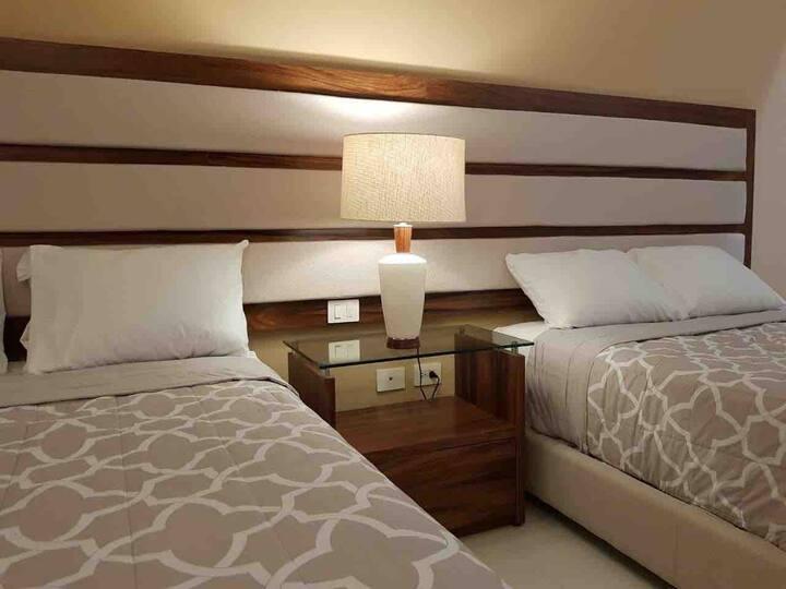 Preciosa y Acogedora Suite a 5 min. del Aeropuerto