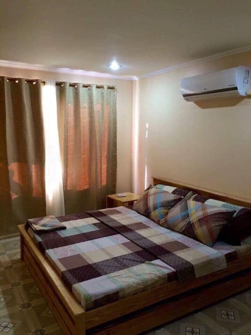 Master's Bedroom.                                                                               -King sized bed with pull-out                                                               - bathroom with heater.                                                                       - can accommodate 3-4 pax                                                                - with split-type aircon