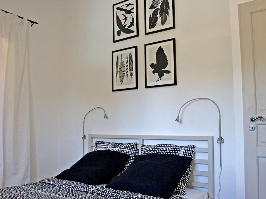 Bedroom with large double bed.
