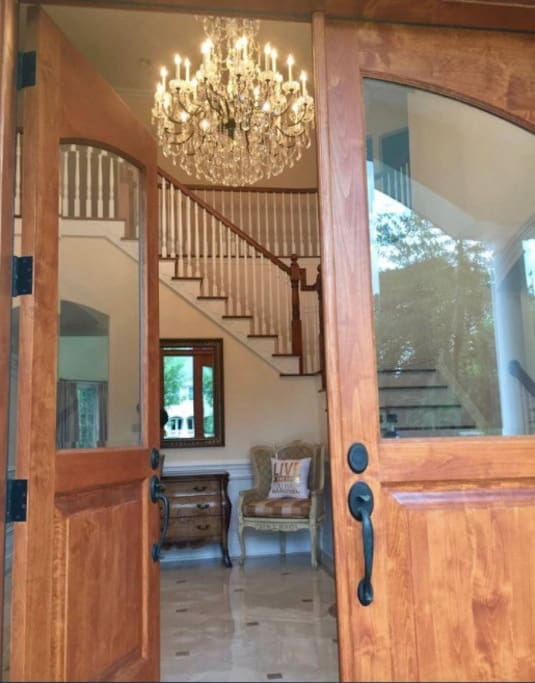 Front entry / foyer with beautiful chandelier