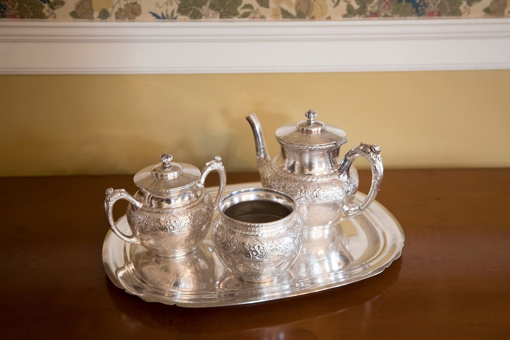 A silver tea set in the dining room.