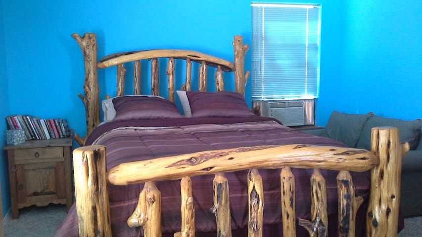 Queen size bed in master bedroom.  This bedframe was handcrafted, made with Juniper wood from the mountains of AZ.
