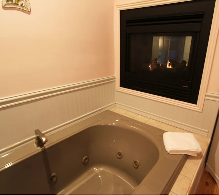 You can enjoy a quiet relaxing whirlpool tub while being warmed by the see through fireplace.