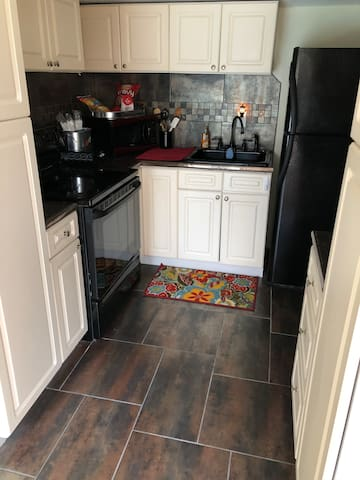 Full kitchen with dishes, pans etc