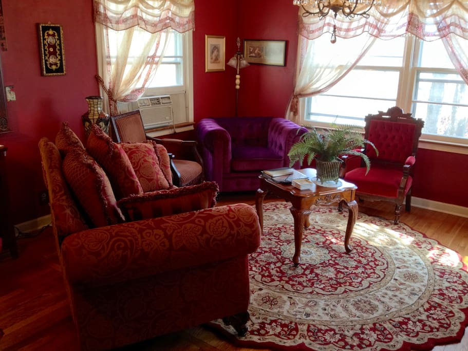 Another view of living room with antique chair