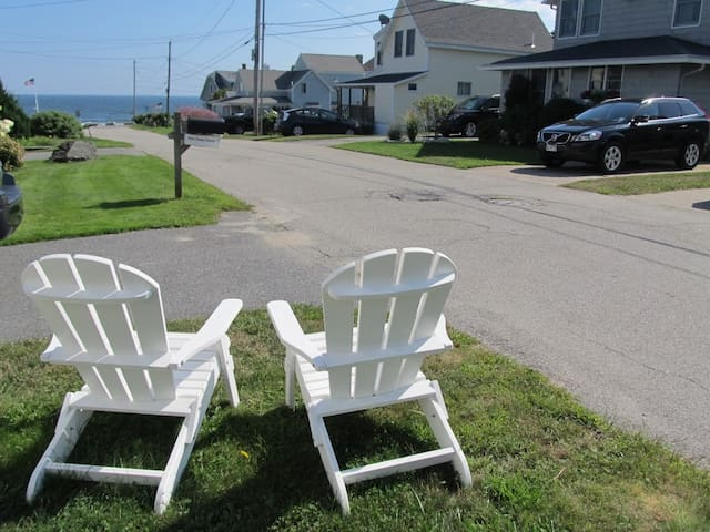 Listen to the surf and watch the waves from the Adirondack chairs on the front lawn.