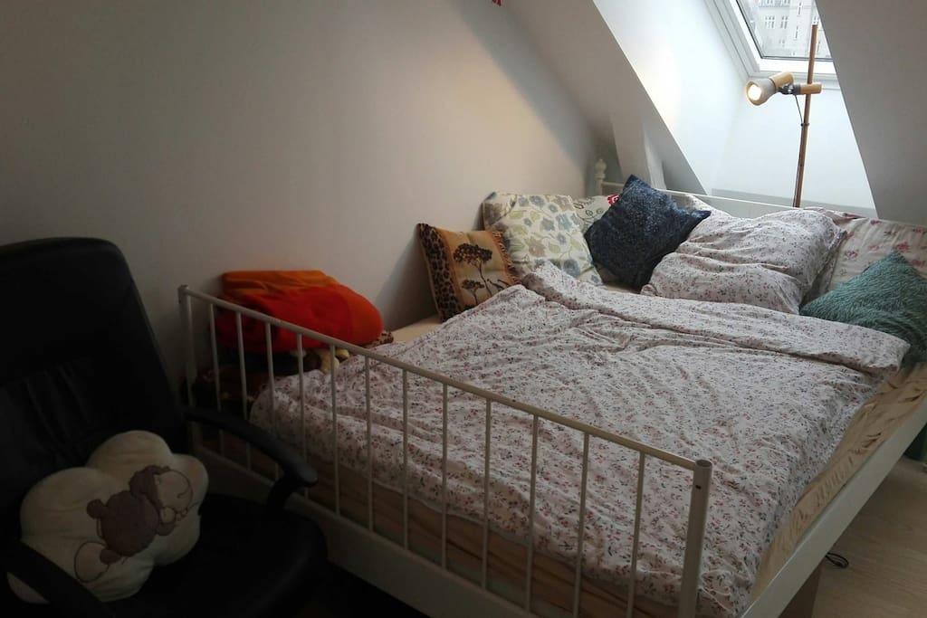 Big double bed under window