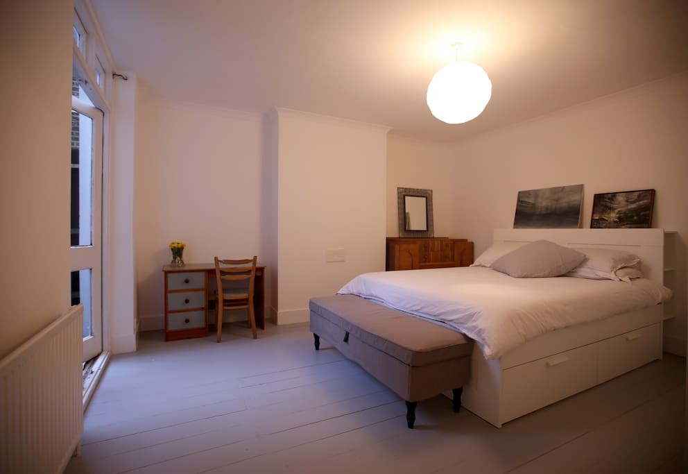 Double room, with desk and french doors onto small private courtyard.