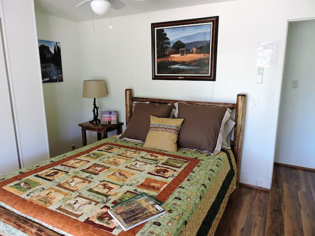 Wildlife quilt accents this queen log bed.