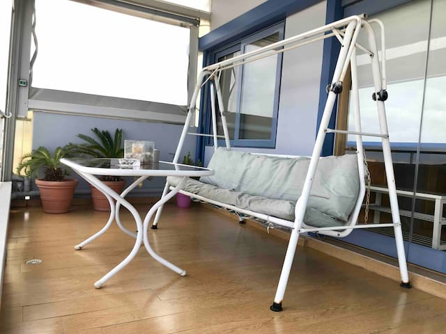 Outdoor swing, perfect for enjoying the stunning view.